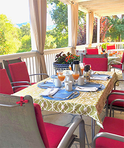 Enjoy our breakfast on our beautiful wraparound veranda or in your room